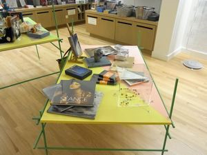 Image of Table with popular merchandise selected by the artist from the Frye Store, from the series Liu Ding's Store